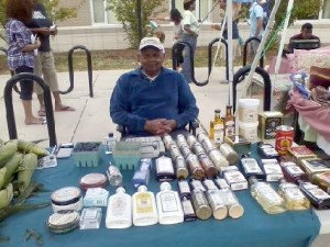 The Price is right! Mr. Price selling Watkins at the farmers' market.