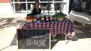 Well House urban gardener, Camilla Voelker, vending at the Southeast Area Farmers' Market.