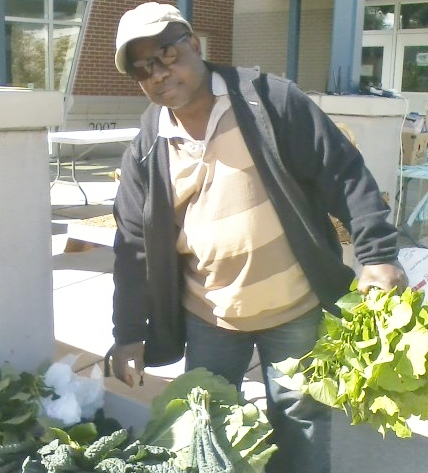 Mr. Henry selling organic collards, kale, mustard and sweet potato greens at the Southeast Area Farmers' Market.